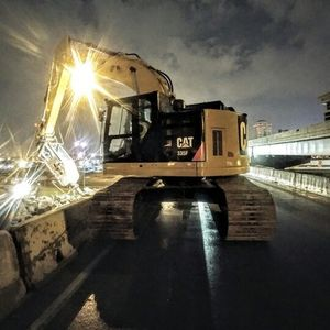 Premier Demolition's late night crew working on the Poplar Street Bridge over the Mississippi River in St. Louis, MO. #Demolition #CAT #CAT335F #STL