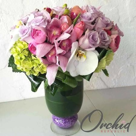 Roses, hydrangeas, cymbidiums, phalaenopsis orchids, and a smiling you.