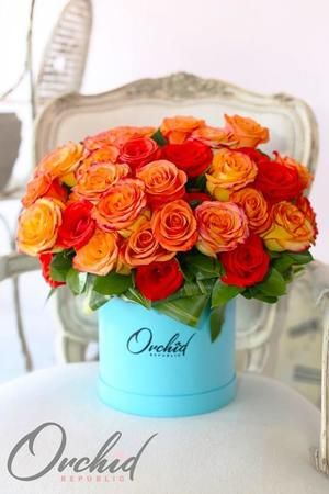 A mesmerizing mix of perfectly shaped roses in stunning sunset hues, yellow tipped with orange