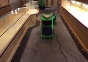 Dehumidifier drying out commercial store from pipe burst.