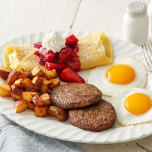 The Farmer's Choice is the best of breakfast on one plate. Eggs cooked how you like them, choice of breakfast meat, home fries and choice of item from our griddle, including our strawberry-topped crepes!