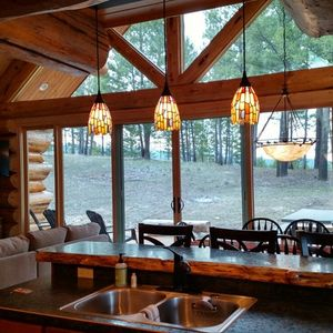 Peaceful view from another Northwest log homes happy customer's kitchen.