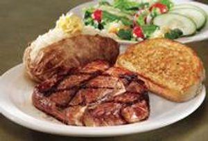 Ribeye dinner with Texas toast, baked potato and salad