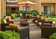 Relax and unwind in our beautifully landscaped outdoor space. Whether you've spent all day at work in meetings or just want to wind down, you'll love this secluded oasis.