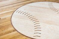 """Say """"custom hardwood floor design"""" and most people probably think of a herringbone floor or a more formal pattern we're accustomed to seeing in large, historic buildings . They probably don't think of baseball medallion. But we do!"""