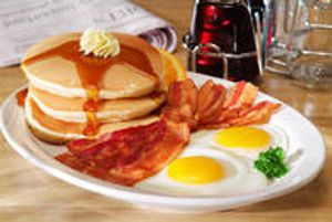 Bacon, Eggs & Pancakes with syrup and butter