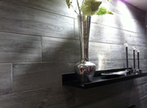 These walls are beautifully adorned with Daltile wood looking porcelain tile so timeless looking as easy to maintain.