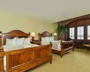 Guest room with two queen beds and waterfront views