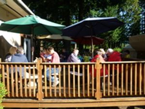 Start your day with our pancake breakfast under a canopy of trees. While visiting with people from all around the world.