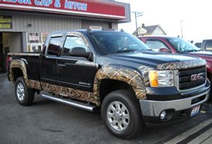 This auto body shop and truck accessory supplier offers truck caps, hitches, van uplifting, and other accessories.