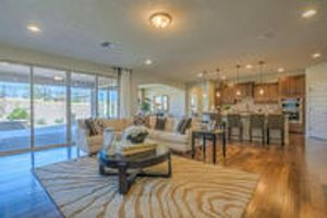 Opening gathering room with large sliding glass door to outdoor covered patio