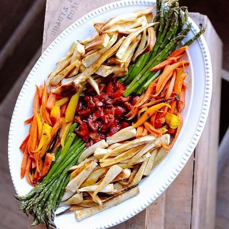 Roasted vegetable platter with asparagus, red peppers, carrots and parsnips.