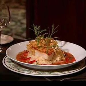 Chilean sea bass over a shrimp risotto is one of the seafood specialties at Christinis