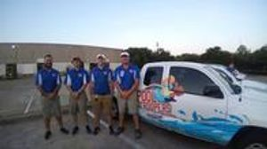 Pool Troopers Technicians Next to a Pool Troopers Service Vehicle