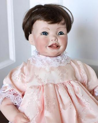 We have several porcelain dolls in the shop! Stop by to check them out!