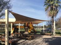 We specialize in playground and park shade structures.