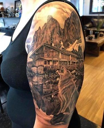 Cabin/wolf tattoo