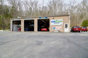 """The Car Care Center started off small, founded by Paul Smith Sr. Still in the family, the shop is now run by Paul Smith. It really began much earlier, but the shop you know and love opened its doors in 1989. Before The Car Care Center, Paul Sr. opened up a series of small auto repair shops built with integrity as the foundation of his business model. While a skilled mechanic, the business side of the automotive world took Paul a few attempts to master. In 1981 Paul Sr. and his family moved to a small house on Charlotte Pk. in West Nashville, just behind the Chick-fil-A. Behind the house there was a small garage, with dirt floors and no garage door. We took weekly trips to K-Mart to gather old cardboard boxes that we stapled together to create a makeshift garage door. By word of mouth, our neighborhood garage began to grow. By 1986 we moved Paul's Garage to a real shop in West Nashville and hired a small team of mechanics. The business grew steadily over the next few years, and in 1989 the Smith Family was able to purchase the property required to build the garage of our dreams from the ground up. To let customers know a new auto shop was on the way, Paul Sr. posted a """"Car Care Shop Coming Soon"""" sign on the building. Everyone started asking when """"The Car Care Shop"""" was opening, so we decided to change the name. In 2015, Paul Sr. retired and his family took over the shop. Still a family affair, it's not uncommon to find one of my 6 children running around and helping in the garage."""