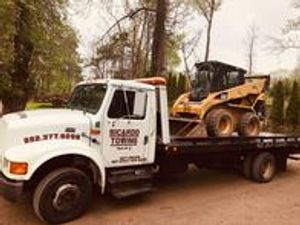 Need to tow some construction equipment? Our truck can handle large and small tows!