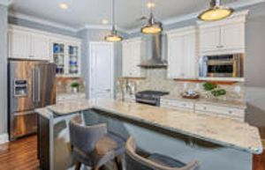 Beautiful gourmet kitchens with islands and stainless steel appliances