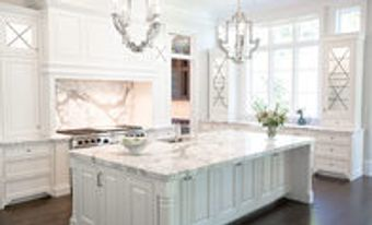 Professional installed countertops, cabinets and flooring.