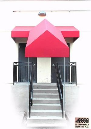 A. Hoffman Awning in Baltimore     410-685-5687     How cute is this stairway awning that covered the doorway then came down the stairway ..Not only did it provide employee safety, but enhanced the facade of the building.