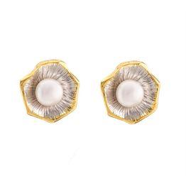 Χειροποίητα σκουλαρίκια από δίχρωμο ασήμι με μαργαριτάρια