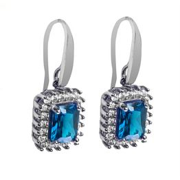 Εντυπωσιακά μακριά σκουλαρίκια ροζέτες από ασήμι με μπλε και λευκές καρφωμένες πέτρες ζιργκόν