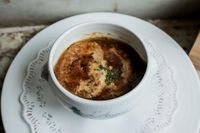 Traditional French Onion Soup with Grated Cheese Crouton