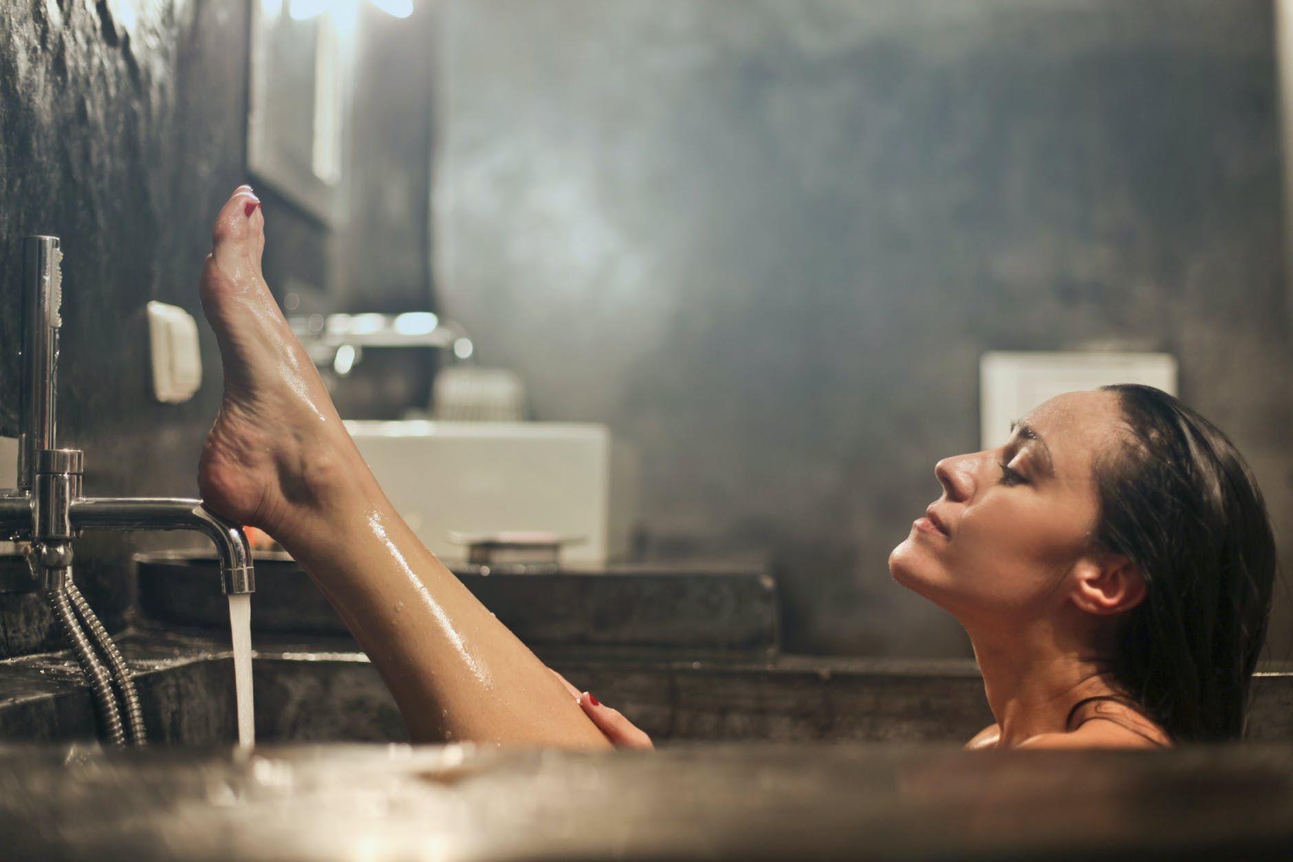 woman on gray concrete bath tub