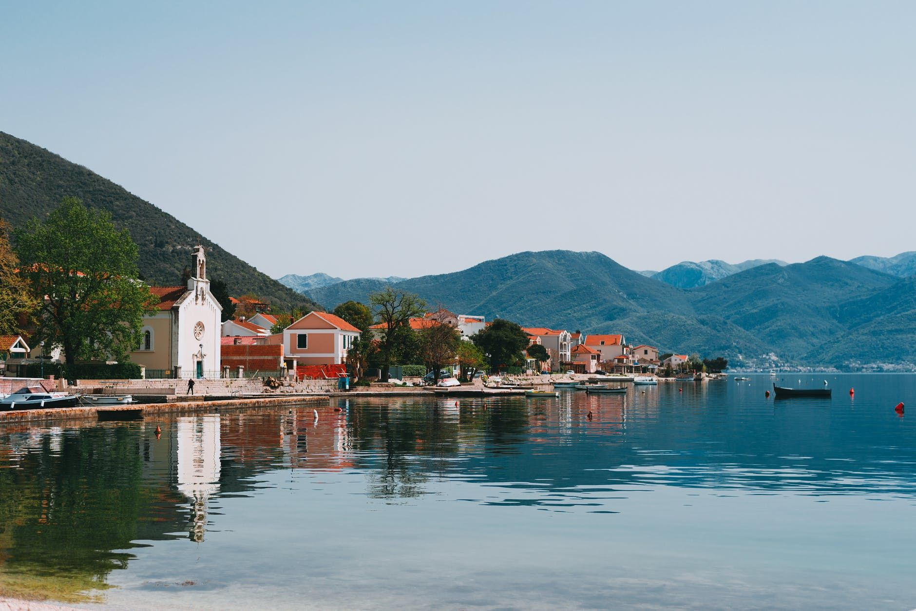 coastal village on peaceful hilly lake shore