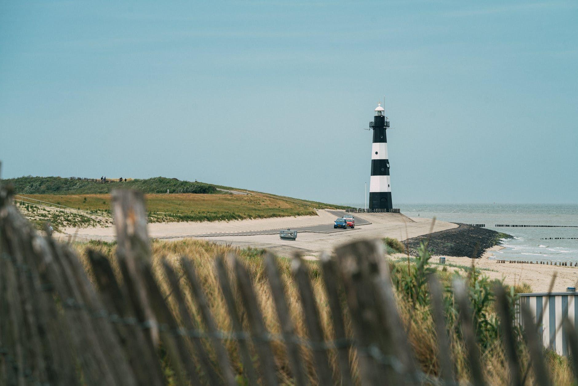 solitude lighthouse on coastline at sea