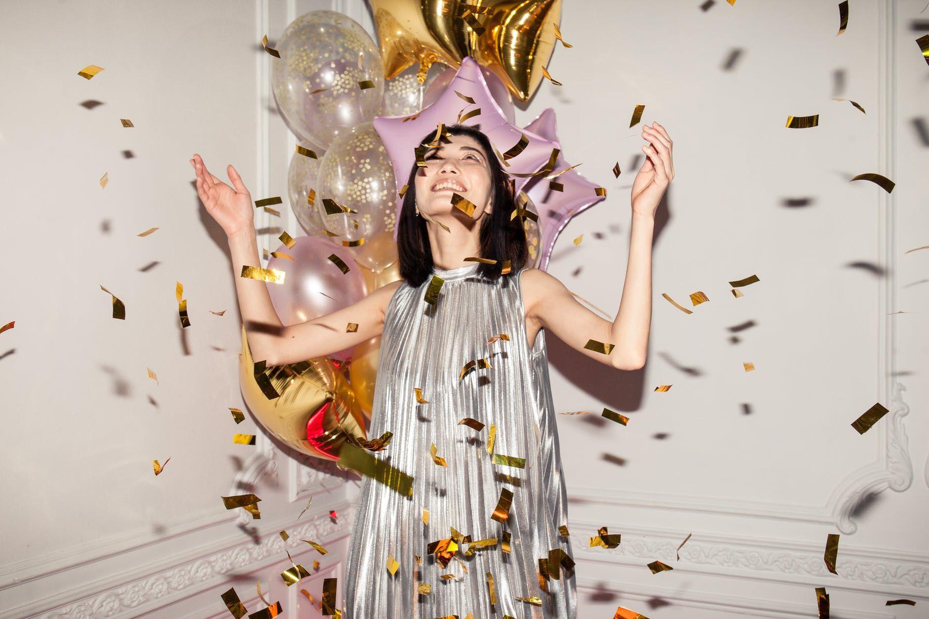 woman looking at falling confetti