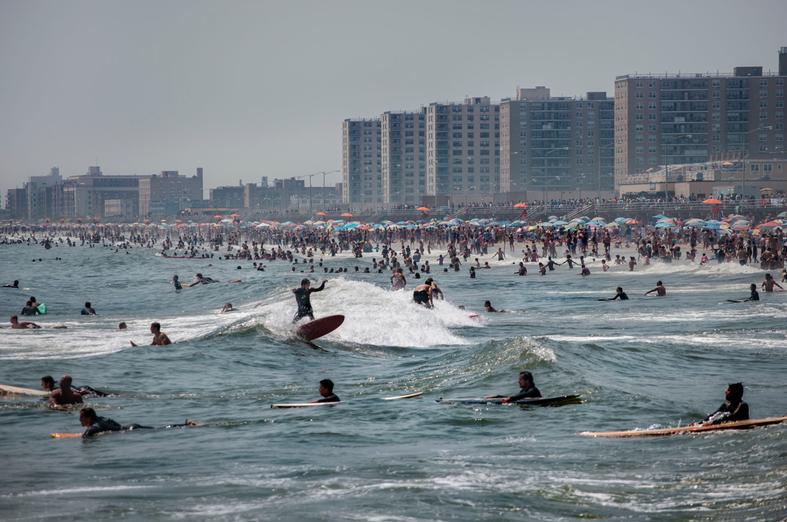 Surfers enjoying a busy day on a Rockaways Beach.