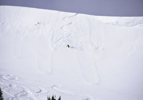 Skier Skiing Steep Slope Cornice Sekirk Mountains Canada.  ProPhoto RGB.