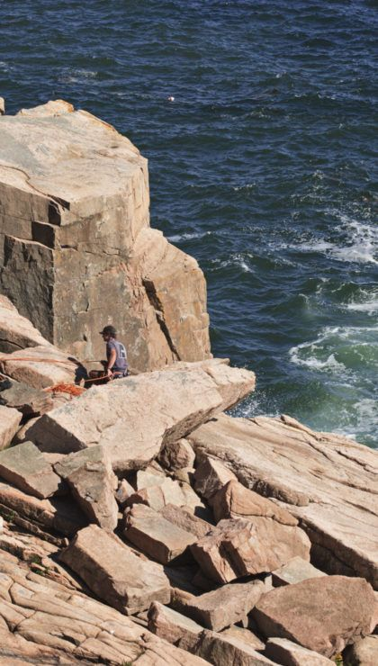 Acadia National Park, Maine, United States - August 24, 2010:Rock climbers prepare to descend Otter Cliffs in Acadia National Park. Guides from Bar Harbor lead classes in rock climbing for beginners.