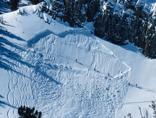 Five backcountry skiers cross a avalanche path while hiking outside of Jackson Hole Resort, Wyoming.