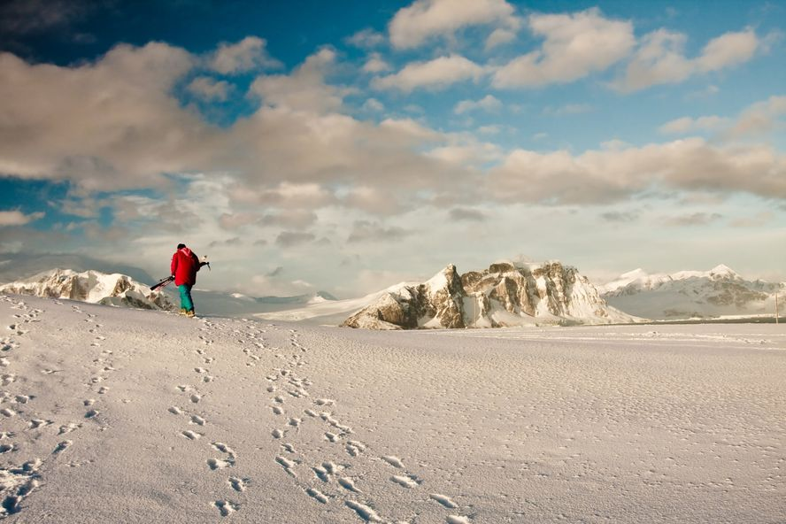 Lone man with skis in Antarcrtica