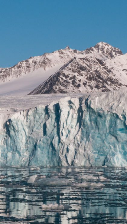 Inflatable boat in front of Glacier in Svalbard