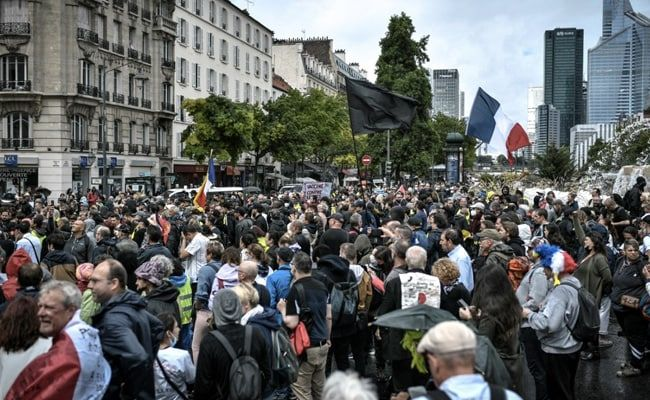 France Implements President Macron's Covid Health Pass Despite Protests