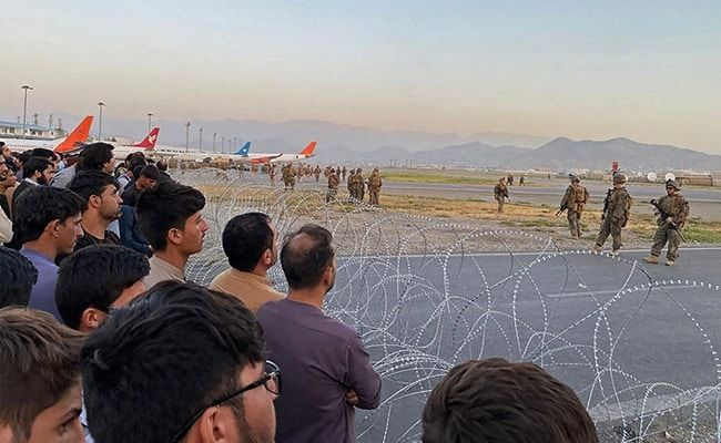 US Troops Fire Shots In Air As Crowd Mobs Tarmac At Kabul Airport: Report