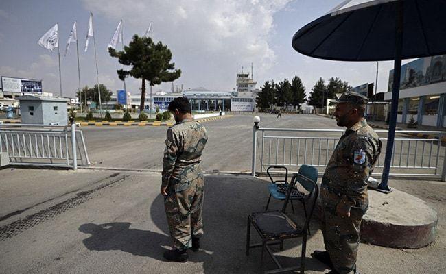 Afghan Police Back At Work Alongside Taliban At Airport