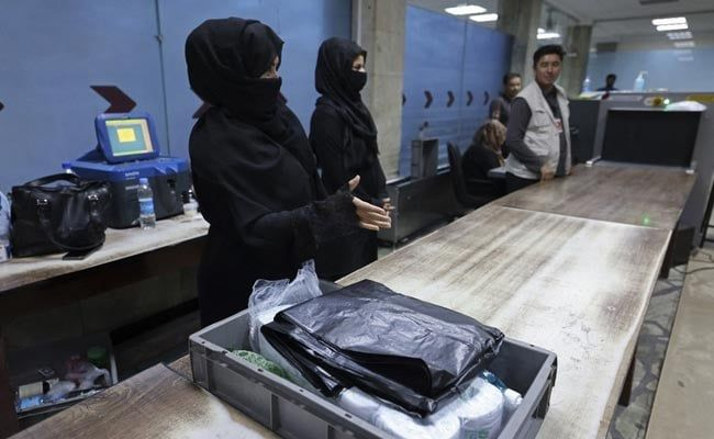 12 Afghan Women Brave Fears To Return To Work At Kabul Airport