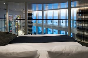 Royal Caribbean International Quantum of the Seas Accommodation Royal Loft Suite Bed.jpg