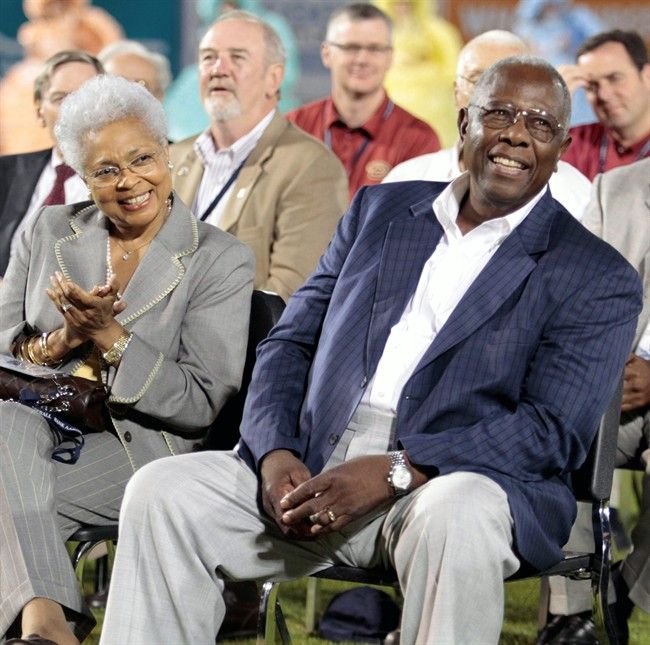 In this April 14, 2010, file photo, baseball great Hank Aaron, right, and his wife Billye listen during dedication ceremonies for the Hank Aaron Childhood Home and Museum at Hank Aaron Stadium in Mobile.