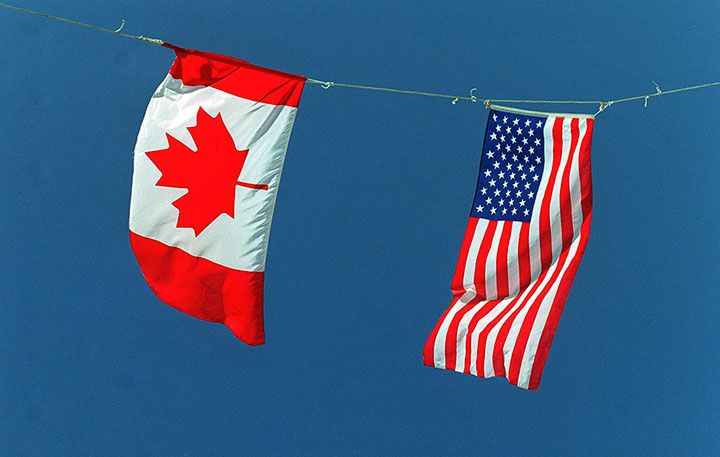 A Canadian and American flag are pictured in this undated file photo.