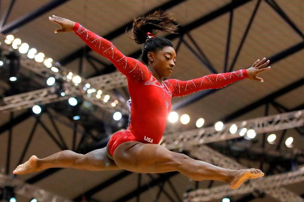 Bronze medalist Simone Biles of the U.S. performs on the balance beam on the second and last day of the apparatus finals of the Gymnastics World Championships at the Aspire Dome in Doha, Qatar, Saturday, Nov. 3, 2018.
