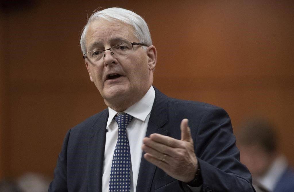 Minister of Transport Minister Marc Garneau responds to a question during Question Period in the House of Commons Thursday December 12, 2019 in Ottawa. A new federal rebate program to encourage Canadians to buy electric cars is proving more popular than expected. THE CANADIAN PRESS/Adrian Wyld.