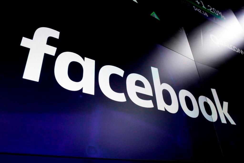 """FILE - This March 29, 2018 file photo, shows the logo for social media giant Facebook at the Nasdaq MarketSite in New York's Times Square. Facebook said Monday Jan. 6, 2020 that it is banning """"deepfake"""" videos, the false but realistic clips created with artificial intelligence and sophisticated tools, as it steps up efforts to fight online manipulation. (AP Photo/Richard Drew, File)."""