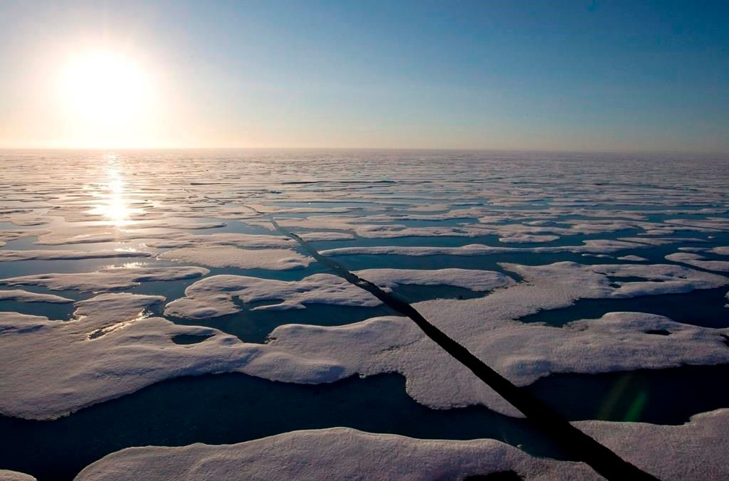 The midnight sun shines over the ice-covered waters near Resolute Bay at 1:30 a.m. as seen from the Canadian Coast Guard icebreaker Louis S. St-Laurent on Saturday, July 12, 2008.